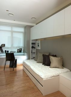 25 Cool Guest Bedroom And Home Office Combos a small contemporary bedroom with a sleeping space, cab Guest Room Decor, Guest Room Office, Office Sofa, Home Office, Contemporary Bedroom, Modern Bedroom, Modern Apartment Design, Trendy Bedroom, Guest Bedrooms