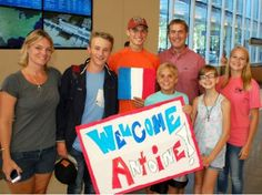 Be a Host Family! This excited host family is waiting at the airport for their French exchange student.