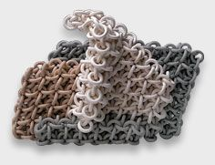 a fascinating sculpture artist, who works in ceramic chain mail, of all things. Gorgeous, but very fragile.
