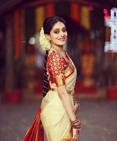 Looking for half saree color combinations ? Check out 21 cool looking half saree designs with trending colors and modern appeal. South Indian Bride Saree, Indian Bridal Sarees, Kerala Bride, Bridal Silk Saree, Hindu Bride, Indian Bridal Fashion, Silk Sarees, Wedding Sarees, South Indian Bride Hairstyle