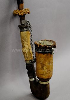 large high relief carved horn tobacco pipe
