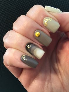 I saw a pic of a mani with no credit for the artist, but I wanted recreate it. I used Essie Marshmallow, Color Club Who Re You Wearing?, and Nomatic Fanatic, Jessica Flutter, Revlon Stormy Night, and Essie Little Brown Dress.