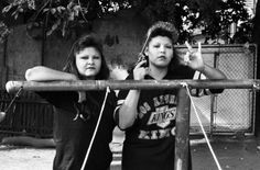 BooBoo (right) flashes a Playboys gang hand sign, 1993, Robert Yager