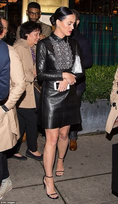 Still provocative: Katy Perry, 31, donned a black leather dress that skimmed her thighs right above the knee for her night out on Friday