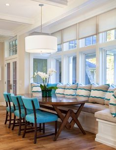 Dining Room decor ideas - small dining breakfast nook with window seat banquet seating, oval shaped table, bright turquoise chairs and drum ceiling pendant Banquette Seating In Kitchen, Kitchen Benches, Dining Nook, Dining Tables, Sunroom Dining, Kitchen Dining, Dining Sets, Kitchen Decor, Bench Seat Dining Room