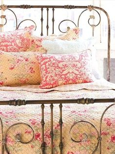 Cozy Vintage Bed. Love it all - the colors, wrought iron bed stand, sunlit room. . .