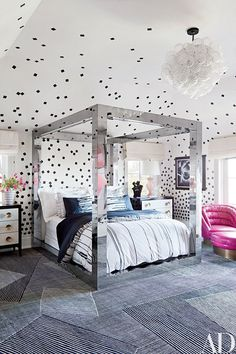 The daughter's bedroom, with its Paul Evans four-poster, is sheathed in a custom-made wall covering by Porter Teleo | archdigest.com