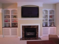 Fireplace cabinets  coloured wood on top of cabinet shelves set back a couple inches