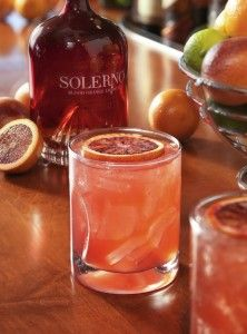 Blood Orange Fizz  Ingredients 1 oz. Solerno Blood Orange Liqueur 1 oz. Stoli ..25 oz. Monin Blood Orange Syrup 1 oz. Fresh Lemon Sour  Directions Add in shaker over ice. Shake and pour with ice into bucket glass, top with 1 oz Club Soda. Garnish with a fresh cut Blood Orange wheel.