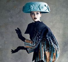 Christian DiorDior couture JKT    This one had to go on hats.  She looks like she is wearing the family fruit bowl!