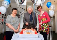 Niall Tóibín who opened Garter Lane Arts Centre 30 years ago is pictured just before the blowing out of the candles on the cake to celebrate the 30th Birthday of the centre with Lily O'Reilly, General Manager and Artistic Director Caroline Senior www.noelbrownephotographer.com — at Garter Lane Arts Centre.