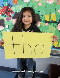 Take a photo of each child holding a sight word.  Create a power point with the pictures to use in phonics sessions. Display in the classroom.