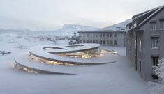 Danish firm BIG has been commissioned to expand the headquarters of Swiss watchmaker Audemars Piguet by adding a spiralling museum that coils up from the landscape.