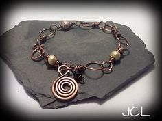 Copper and pearls linked bracelet with spiral charm