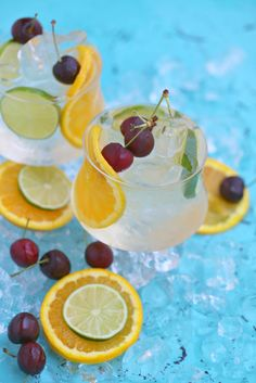Coconut Citrus Sangria - Today I want to share with you a refreshing tropical sangria made with white wine, coconut water, citrus, fresh cherries and sparkling orangeade all items I picked up on my latest visit to Sprouts. I simply add everything to my pitcher, place in the fridge to chill & allow flavors to meld while I frantically clean my living room (pre-sangria work-out, LOL) and I'm all set to entertain.