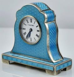 View this item and discover similar for sale at - Beautiful enamel and sterling silver miniature mantel clock. Made and signed by Cartier. All over teal blue guilloche enamel. White dial with Roman numerals. Retro Clock, Objet D'art, Roman Numerals, Silver Enamel, Teal Blue, Antique Gold, Diamond Jewelry, Miniatures, Tic Toc