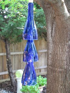 Wine Bottle Wind Chimes @Chelsey McDonald  now we can use the bottles for something aswell :) let the wine drinking begin