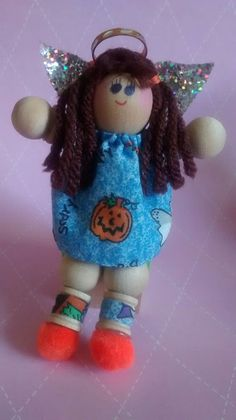 Handmade, palm-sized wood and cloth angel dolls by AngelsByElaine