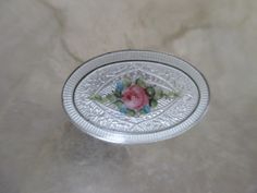 Antique Guilloche enamel button with hand painted rose under glass, set in sterling silver.  Gorgeous!