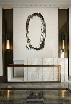 Black feather logo behind the desk and stamped concrete floors to look like marble.