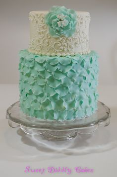 Teal petal and scroll work cake. Beautiful for birthday's, weddings, anniversary or any special occasion.