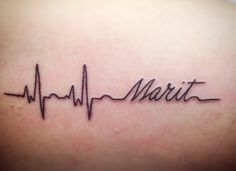 My First tattoo.  Heart beat with name of my daughter.