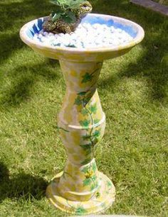 clay pot bird bath... maybe covered in bottle caps...