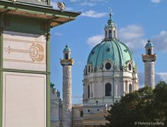Karlskirche, Vienna. The St. Charles's Church is situated on the edge of the 1st dirtrict of Vienna. The construction of the baroque chruch started 1716. In front an detail of an Art Nouveau pavilion, created by Otto Wagner. Image by Helena Ludwig