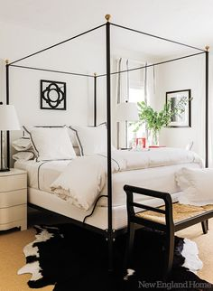 black & white bedroom, canopy bed, cowhide rug, white bedding