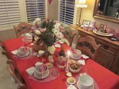 """Table setting for friends :) I actually painted the little heart vases at Color Me Mine for our guests to take home... just a little """"I love you"""" reminder"""