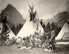 "Blackfoot group (John ""Two Guns"" White Calf) , Montana. Early 1900s. Photo by Roland W. Reed"