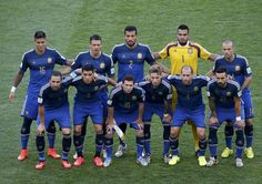 Argentina's team poses for pictures before the start of their 2014 World Cup final against Germany at the Maracana stadium in Rio de Janeiro July 13, 2014.