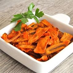 "Carrot Chips | ""This is a healthy alternative to potato chips and taste salty and sweet like sweet potato fries. This recipe is inspired by other recipes on the internet that I have played with. The thinner the slices, the crunchier the chips."""