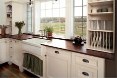 Love the plate rack and farmhouse sink.