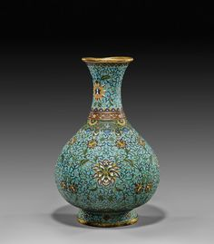 CHINESE CLOISONNÉ ENAMEL VASE   銅胎掐絲琺瑯纏枝蓮紋瓶  Chinese Qianlong-style, cloisonné enamel vase; of bulbous bottle form, decorated with Buddhist-motif of scrolling lotus on a turquoise ground; H: 12 1/2""