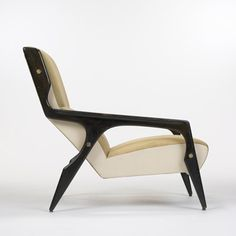 Lot 106: Gio Ponti. armchair from the Hotel Parco dei Principi, Rome. 1964, lacquered walnut, upholstery, skai, brass. 28½ w x 38 d x 34 h in. result: $60,000. estimate: $50,000–70,000. Signed with decal manufacturer's label to underside: [Figli Di Amedeo Cassina Meda Italy]. Provenance: Hotel Parco dei Principi, Rome