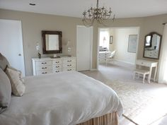 vanity and white furniture beige walls