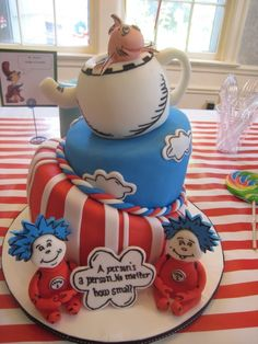 Dr Seuss - This was made for a baby shower in preparation for twin boys. The nursery theme was Dr Seuss. My first attempt at a topsy turvey cake Dr. Seuss, Dr Seuss Cake, Twin Baby Shower Theme, Baby Shower Table, Baby Shower Cakes, Baby Boy Shower, Dr Seuss Baby Shower Ideas, Dr Seuss Birthday Party, Baby Boy Birthday
