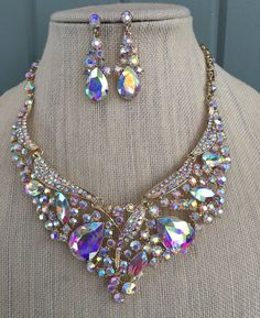 Beautiful Aurora Borealis rhinestone necklace and earring set! Fit for a queen! Sparkly iridescent rhinestones are set in a gorgeous gold tone