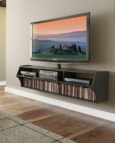 "The minimalist, off-the floor design of the Altus Plus eliminates the need for a separate wall-mount TV bracket and is the perfect pairing for any flat screen TV up to 60"".  At 58 inches wide, it boasts three compartments for A/V components and a bottom shelf for media with room for 137 Blu-Ray Discs or 93 DVDs.  Cables & power bars can be neatly concealed to maintain a clean, modern look.  When installed according to the manufacturer's directions, the Altus Plus has a 165lb weight capacity…"