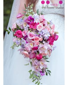 The Courtyard at Lake Lucerne-cascading bouquet with shades of pink and purple with a touch of greens mixed in. Bridal Bouquet from Orlando florist The Flower Studio. Wedding Themes, Wedding Colors, Wedding Decorations, Wedding Ideas, Cascade Bouquet, Flower Bouquet Wedding, Green Wedding, Floral Wedding, Cascading Flowers