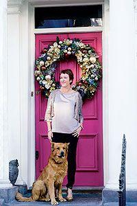 My home at Christmas: Nikki Tibbles   - Pink front door! Giant wreath!
