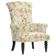 "Featuring a scrolling silhouette and charming floral-print upholstery, this lovely arm chair offers garden-chic inspiration for your living room or den seating group.   Product: Arm chairConstruction Material: Engineered wood, polyurethane foam and linenColor: Beige and pinkFeatures: Turned front legsDimensions: 42.5"" H x 30"" W x 31.37"" DCleaning and Care: Spot clean onlyAssembly: Simple assembly required"