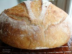 This easy sourdough artisan bread is a kneaded in a mixer and then cooked in an enamel cast-iron pan for a perfect crust and delicious result.
