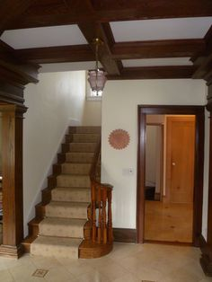 A contractor who renovates old homes in the NJ area, installed crown hardwood moldings for the foyer ceilings - contact him at howdyhood