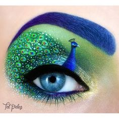 This peacock makeup is carefully hand painted to create a beautiful work of art. Share this look if you think this is awesome!