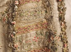 Fashion from 18th century ball gown dress Robe a la Francaise circa from French in 1754-1793. #Historical #Costume made from woven silk fabric brocade with metallic gold thread in flowers floral design, lace and garland trim at the neckline, front bodice with ruffles frills falling sleeves. The skirt is open at the front, and away from the waist towards the sides, with train at the back. #Vintage #Rococo #Fashion