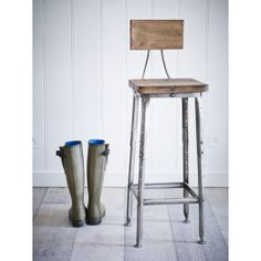 The strong iron frame on this industrial style stool features faux rivet detailing down the legs and a rustic mango wood seat and back rest. Important: Please check the height of these stools are suitable for your intended use ie. breakfast bar or under a table.