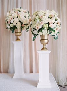 Rose, hydrangea and eucalyptus wedding flowers: http://www.stylemepretty.com/little-black-book-blog/2016/12/01/elegant-glamorous-baltimore-ballroom-wedding/ Photography: Michael and Carina - http://www.michaelandcarina.com/