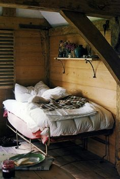 Cabin life- great idea to mount a simple rustic shelf above the bed as a stand-in bedside table. Would be great in the boys' room on the vertical wall next to Brandon's twin, would be a nice place to set glasses, water bottle, or book...